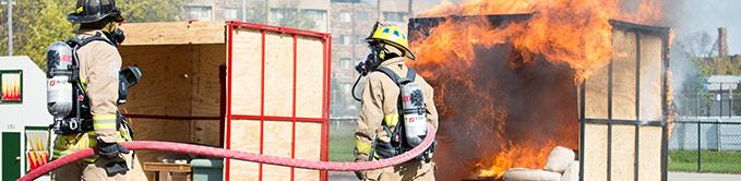 Firemen Training With Hoses and Fire